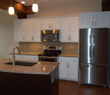 Birkett Landing Apt Kitchen White Cabinets